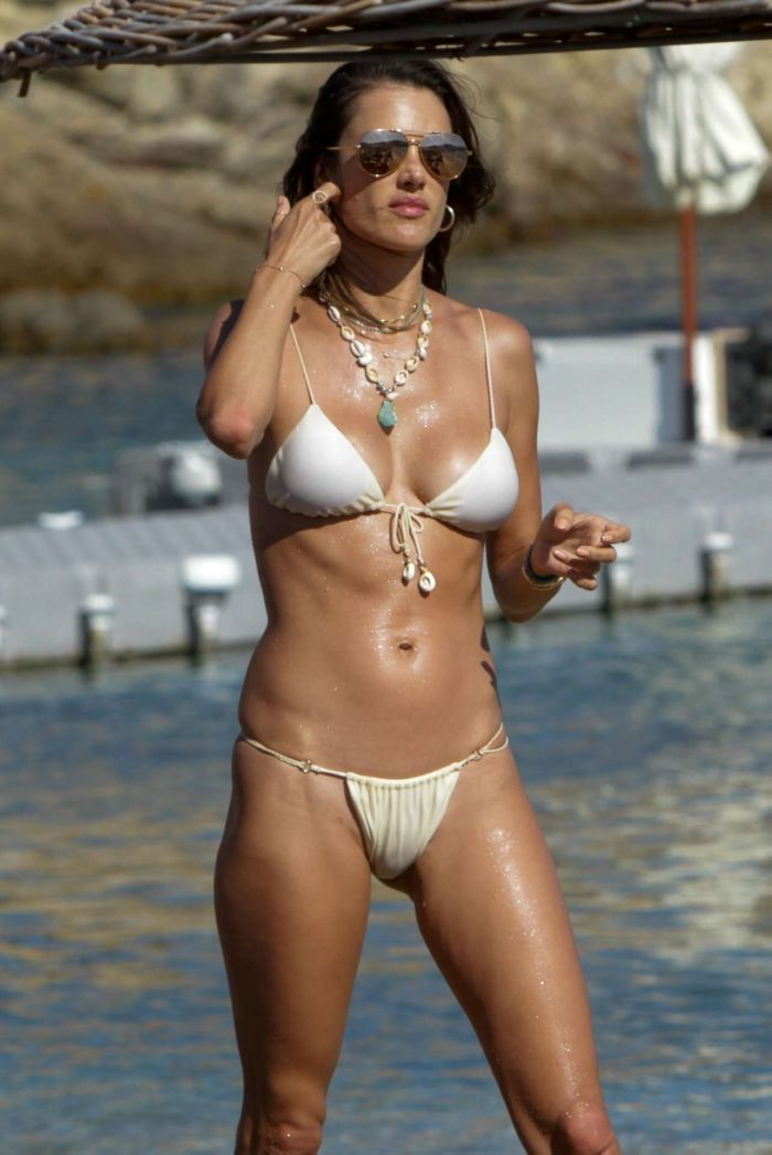 Alessandra Ambrosio Candids In A White Bikini On The Beach In Mykonos